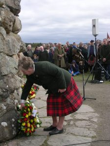 Ann laying a wreath at Culloden